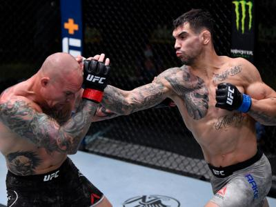 LAS VEGAS, NEVADA - AUGUST 29: (R-L) Aleksandar Rakic of Austria punches Anthony Smith in their light heavyweight fight during the UFC Fight Night