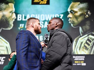 LAS VEGAS, NEVADA - MARCH 04: (L-R) Opponents Jan Blachowicz of Poland and Israel Adesanya of Nigeria face off during the UFC 259