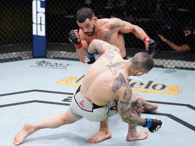 LAS VEGAS, NEVADA - MARCH 13: (L-R) Dan Ige knocks out Gavin Tucker of Canada in a featherweight fight during the UFC Fight Night event at UFC APEX