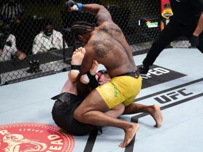 LAS VEGAS, NEVADA - MARCH 13: (R-L) Ryan Spann punches Misha Cirkunov of Latvia in a light heavyweight fight during the UFC Fight Night