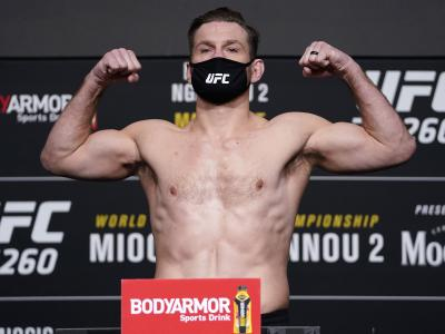 LAS VEGAS, NEVADA - MARCH 26: Stipe Miocic poses on the scale during the UFC 260