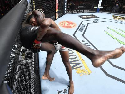 LAS VEGAS, NEVADA - MARCH 27: (R-L) Alonzo Menifield takes down Fabio Cherant in their light heavyweight fight during the UFC 260 e
