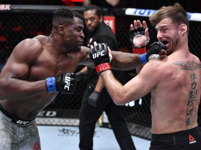 LAS VEGAS, NEVADA - MARCH 27: (L-R) Francis Ngannou of Cameroon punches Stipe Miocic in their UFC heavyweight championship fight during the UFC 260