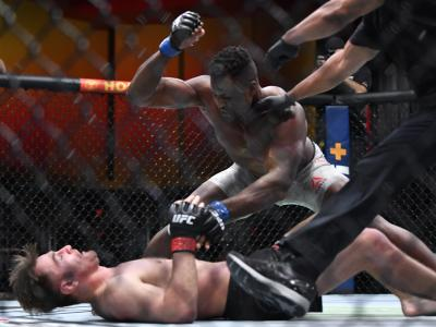AS VEGAS, NEVADA - MARCH 27: (R-L) Francis Ngannou of Cameroon punches Stipe Miocic in their UFC heavyweight championship fight during the UFC 260