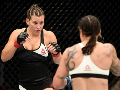 NEW YORK, NY - NOVEMBER 12: Miesha Tate of the United States (left) fights against Raquel Pennington of the United States in their women's bantamweight bout during the UFC 205