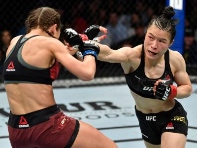 LAS VEGAS, NEVADA - MARCH 07: (R-L) Zhang Weili of China punches Joanna Jedrzejczyk of Poland in their UFC strawweight championship fight during the UFC 248