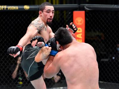 LAS VEGAS, NEVADA - APRIL 17: In this handout photo, (L-R) Robert Whittaker of Australia kicks Kelvin Gastelum in a middleweight fight during the UFC Fight Night event at UFC APEX