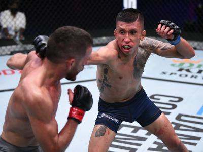 LAS VEGAS, NEVADA - AUGUST 25: (R-L) Jeffrey Molina punches Jacob Silva in a flyweight bout during week four of Dana White's Contender Series