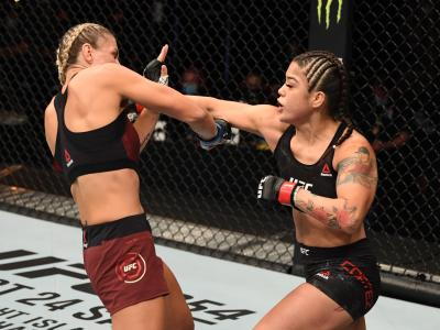 ABU DHABI, UNITED ARAB EMIRATES - OCTOBER 11: (R-L) Tracy Cortez punches Stephanie Egger of Switzerland in their women's bantamweight bout during the UFC Fight Night