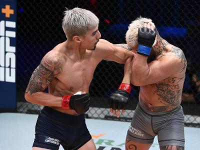 LAS VEGAS, NEVADA - NOVEMBER 04: (L-R) Luis Saldana elbows Vince Murdock in a featherweight fight during Dana White's Contender Series