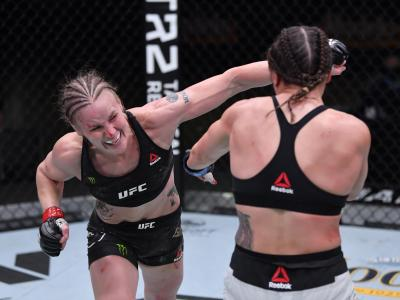 LAS VEGAS, NEVADA - NOVEMBER 21: (L-R) Valentina Shevchenko of Kyrgyzstan punches Jennifer Maia of Brazil in their women's flyweight championship bout during the UFC 255