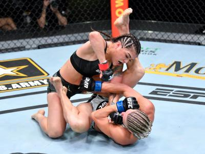 LAS VEGAS, NEVADA - APRIL 17: (L-R) Tracy Cortez punches Justine Kish in a flyweight fight during the UFC Fight Night event at UFC APEX