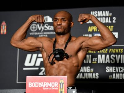 JACKSONVILLE, FLORIDA - APRIL 23: Kamaru Usman of Nigeria poses on the scale during the official UFC 261