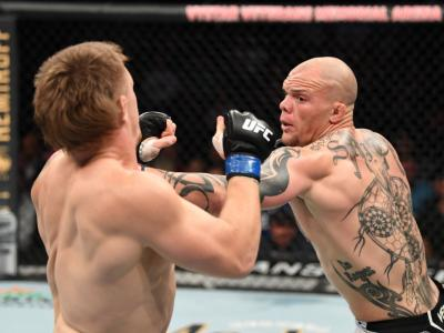 JACKSONVILLE, FLORIDA - APRIL 24: (R-L) Anthony Smith punches Jim Crute of Australia in their light heavyweight bout during the UFC 261