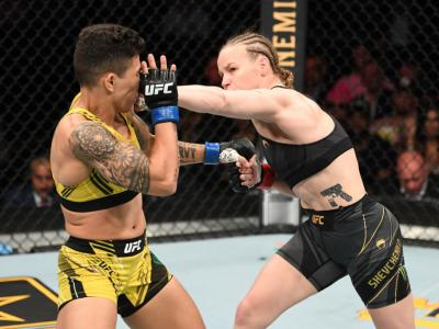 JACKSONVILLE, FLORIDA - APRIL 24: (R-L) Valentina Shevchenko of Kyrgyzstan punches Jessica Andrade of Brazil in their UFC women's flyweight championship bout during the UFC 261