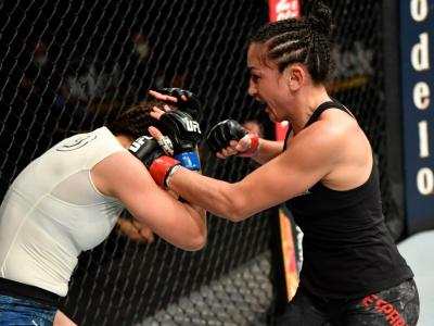 ACKSONVILLE, FLORIDA - MAY 09: (R-L) Carla Esparza punches Michelle Waterson in their strawweight fight during the UFC 249