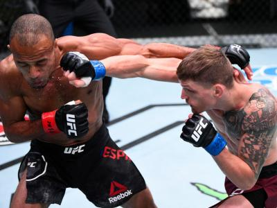 LAS VEGAS, NEVADA - SEPTEMBER 19: (R-L) David Dvorak of the Czech Republic punches Jordan Espinosa in their flyweight bout during the UFC Fight Night