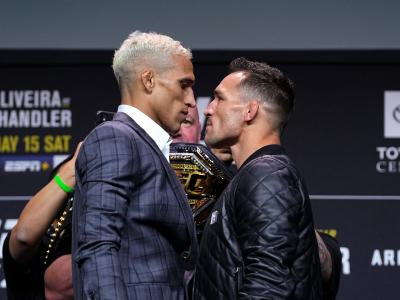 HOUSTON, TEXAS - MAY 13: (L-R) Opponents Charles Oliveira and Michael Chandler face off during the UFC 262