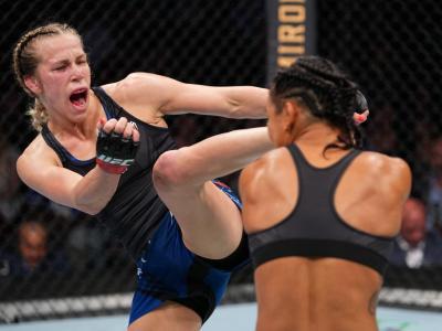 HOUSTON, TEXAS - MAY 15: (L-R) Katlyn Chookagian kicks Viviane Araujo of Brazil in their women's flyweight bout during the UFC 262