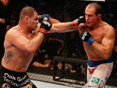 HOUSTON, TEXAS - OCTOBER 19: (L-R) Cain Velasquez punches Junior Dos Santos in their UFC heavyweight championship bout at the Toyota Center on October 19, 2013 in Houston, Texas