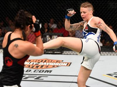 OTTAWA, ON - JUNE 18:   (R-L) Joanne Calderwood of Scotland kicks Valerie Letourneau of Canada in their women's flyweight bout during the UFC Fight Night event inside the TD Place Arena on June 18, 2016 in Ottawa, Ontario, Canada. (Photo by Jeff Bottari/Z