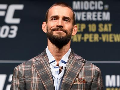 CLEVELAND, OH - SEPTEMBER 08:   Phil CM Punk Brooks poses for photos during the UFC 203 press conference at Quicken Loans Arena September 8, 2016 in Cleveland, Ohio. (Photo by Josh Hedges/Zuffa LLC/Zuffa LLC via Getty Images)