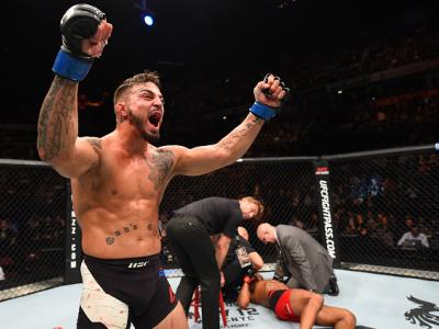 MANCHESTER, ENGLAND - OCTOBER 08:  (L-R) Mike Perry celebrates his knockout victory over Danny Roberts of England in their welterweight bout during the UFC 204 Fight Night at the Manchester Evening News Arena on October 8, 2016 in Manchester, England. (Ph