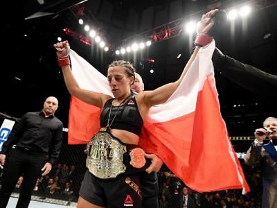 NEW YORK, NY - NOVEMBER 12:  Joanna Jedrzejczyk of Poland is awarded the belt after her unanimous decision victory in their women's strawweight championship bout against Karolina Kowalkiewicz of Poland during the UFC 205 event at Madison Square Garden on