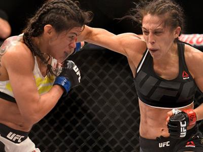 LAS VEGAS, NV - JULY 08:  (R-L) Joanna Jedrzejczyk of Poland punches Claudia Gadelha of Brazil in their women's strawweight championship bout during The Ultimate Fighter Finale event at MGM Grand Garden Arena on July 8, 2016 in Las Vegas, Nevada.  (Photo