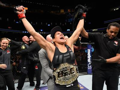 LAS VEGAS, NV - DECEMBER 30:  Amanda Nunes of Brazil reacts to her victory over Ronda Rousey in their UFC women's bantamweight championship bout during the UFC 207 event at T-Mobile Arena on December 30, 2016 in Las Vegas, Nevada.  (Photo by Josh Hedges/Z