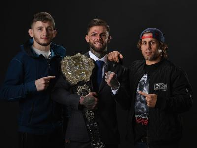 LAS VEGAS, NV - DECEMBER 30:  UFC bantamweight champion Cody Garbrandt (C) poses with Urijah Faber (R) and Chris Holdsworth backstage during the UFC 207 event at T-Mobile Arena on December 30, 2016 in Las Vegas, Nevada.  (Photo by Mike Roach/Zuffa LLC/Zuf