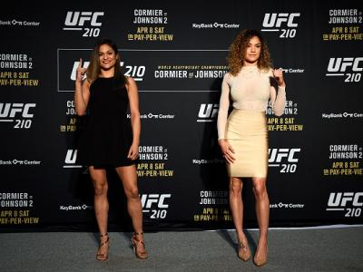 BUFFALO, NEW YORK - APRIL 05:  (L-R) Cynthia Calvillo and Pearl Gonzalez face off during the UFC 210 Ultimate Media Day inside the KeyBank Center on April 5, 2017 in Buffalo, New York. (Photo by Jeff Bottari/Zuffa LLC/Zuffa LLC via Getty Images)
