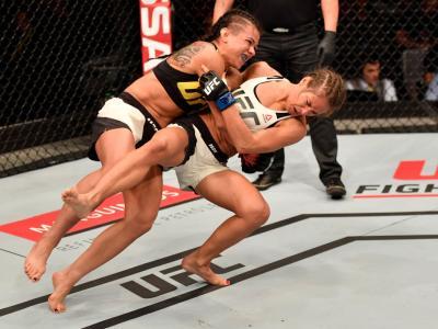 RIO DE JANEIRO, BRAZIL - JUNE 03:  (L-R) Claudia Gadelha of Brazil takes down Karolina Kowalkiewicz of Poland in their womens strawweight bout during the UFC 212 event at Jeunesse Arena on June 3, 2017 in Rio de Janeiro, Brazil. (Photo by Jeff Bottari/Zuf