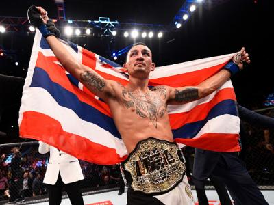 RIO DE JANEIRO, BRAZIL - JUNE 03:  Max Holloway celebrates after his TKO victory over Jose Aldo of Brazil in their UFC featherweight championship bout during the UFC 212 event at Jeunesse Arena on June 3, 2017 in Rio de Janeiro, Brazil. (Photo by Jeff Bot