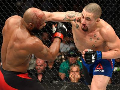 LAS VEGAS, NV - JULY 08:  (R-L) Robert Whittaker of New Zealand punches Yoel Romero of Cuba in their interim UFC middleweight championship bout during the UFC 213 event at T-Mobile Arena on July 8, 2017 in Las Vegas, Nevada.  (Photo by Josh Hedges/Zuffa L