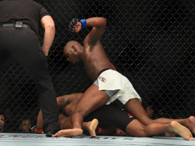 ANAHEIM, CA - JULY 29:  Jon Jones punches Daniel Cormier in their UFC light heavyweight championship bout during the UFC 214 event at Honda Center on July 29, 2017 in Anaheim, California.  (Photo by Sean M. Haffey/Getty Images)