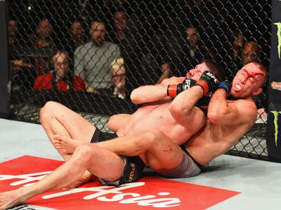 NEW YORK, NY - NOVEMBER 04: Georges St-Pierre of Canada pins Michael Bisping of England in their UFC middleweight championship bout during the UFC 217 event at Madison Square Garden on November 4, 2017 in New York City.  (Photo by Josh Hedges/Zuffa LLC/Zu