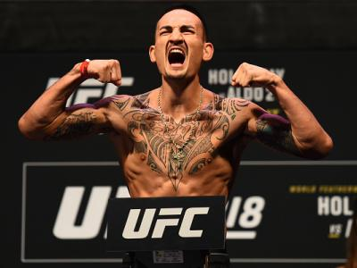 DETROIT, MI - DECEMBER 01:  Max Holloway poses on the scale during the UFC 218 weigh-in inside Little Caesars Arena on December 1, 2017 in Detroit, Michigan. (Photo by Josh Hedges/Zuffa LLC/Zuffa LLC via Getty Images)
