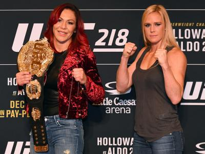 DETROIT, MI - NOVEMBER 30:  (L-R) Opponents Cris Cyborg of Brazil and Holly Holm pose for photos ahead of their UFC 219 fight during the UFC 218 Ultimate Media Day at the DoubleTree Hotel on November 30, 2017 in Detroit, Michigan. (Photo by Josh Hedges/Zu
