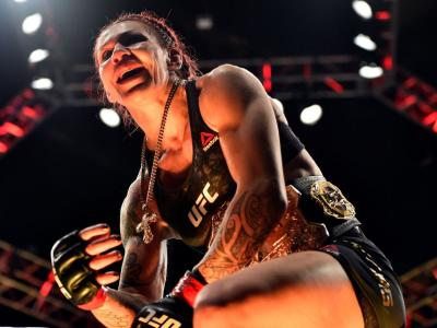LAS VEGAS, NV - DECEMBER 30:  Cris Cyborg of Brazil celebrates after her victory over Holly Holm in their women's featherweight bout during the UFC 219 event inside T-Mobile Arena on December 30, 2017 in Las Vegas, Nevada. (Photo by Brandon Magnus/Zuffa L