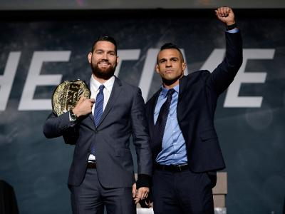 LAS VEGAS, NEVADA - NOVEMBER 17:  UFC middleweight champion Chris Weidman (L) and challenger Vitor Belfort pose for the media during the UFC Time Is Now press conference at The Smith Center for the Performing Arts on November 17, 2014 in Las Vegas, Nevada