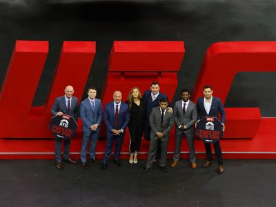 NEW YORK, NY - APRIL 14:  Ultimate Fighing Championship: CEO Lorenzo Fertitta (third from left) poses for a photo with UFC Fighters (L-R) Ryan LaFlare, Chris Wade, Ronda Rousey, Gian Villante, Dennis Bermudez, Aljamain Sterling, Chris Weidman prior to a b