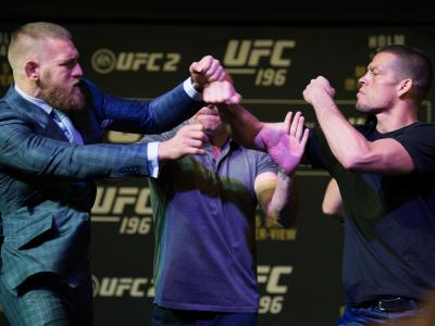 LAS VEGAS, NV - MARCH 3:   (L-R) UFC featherweight champion Conor McGregor throws a punch towards Nate Diaz during the UFC 196 Press Conference at David Copperfield Theater in the MGM Grand Hotel/Casino on March 3, 2016 in Las Vegas, Nevada. (Photo by Bra