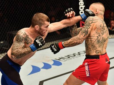 BELFAST, NORTHERN IRELAND - NOVEMBER 19:  (L-R) Stevie Ray of Scotland punches Ross Pearson of England in their lightweight bout during the UFC Fight Night at the SSE Arena on November 19, 2016 in Belfast, Northern Ireland. (Photo by Brandon Magnus/Zuffa