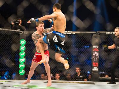 STOCKHOLM, SWEDEN - JANUARY 24: Makwan Amirkhani of Finland (right) comes out with a flying knee on Andy Ogle of England during the UFC Fight Night event at Tele2 Arena on January 24, 2015 in Stockholm, Sweden. (Photo by Michael Campanella/Zuffa LLC/Zuffa