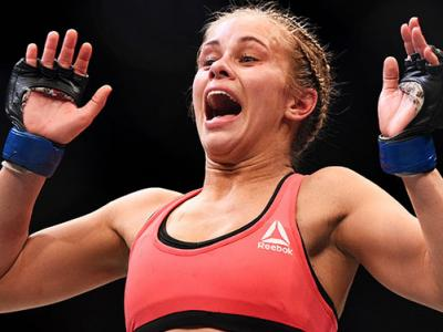 NEWARK, NJ - APRIL 18:  Paige VanZant celebrates defeating Felice Herrig in their women's strawweight bout during the UFC Fight Night event at Prudential Center on April 18, 2015 in Newark, New Jersey.  (Photo by Jeff Bottari/Zuffa LLC/Zuffa LLC via Getty