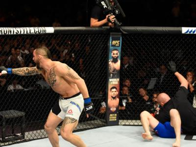 GLASGOW, SCOTLAND - (L-R) Santiago Ponzinibbio of Argentina celebrates his victory over Gunnar Nelson of Iceland in their welterweight bout during the UFC Fight Night event at the SSE Hydro Arena Glasgow on July 16, 2017 in Glasgow, Scotland. (Photo by Jo