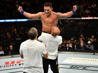 EDMONTON, AB - SEPTEMBER 09:  Rafael Dos Anjos of Brazil celebrates his submission victory over Neil Magny in their welterweight bout during the UFC 215 event inside the Rogers Place on September 9, 2017 in Edmonton, Alberta, Canada. (Photo by Jeff Bottar