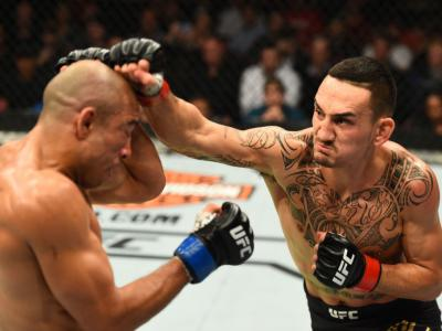 DETROIT, MI - DECEMBER 02:  (R-L) Max Holloway punches Jose Aldo of Brazil in their UFC featherweight championship bout during the UFC 218 event inside Little Caesars Arena on December 02, 2017 in Detroit, Michigan. (Photo by Josh Hedges/Zuffa LLC/Zuffa L