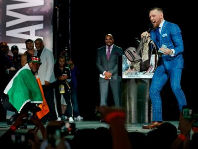 TORONTO, CANADA - JULY 12:  (L-R) Floyd Mayweather Jr. and Conor McGregor interact on stage during the Floyd Mayweather Jr. v Conor McGregor World Press Tour event at the Staples Center on July 12, 2017 in Toronto, Ontario, Canada, California. (Photo by J